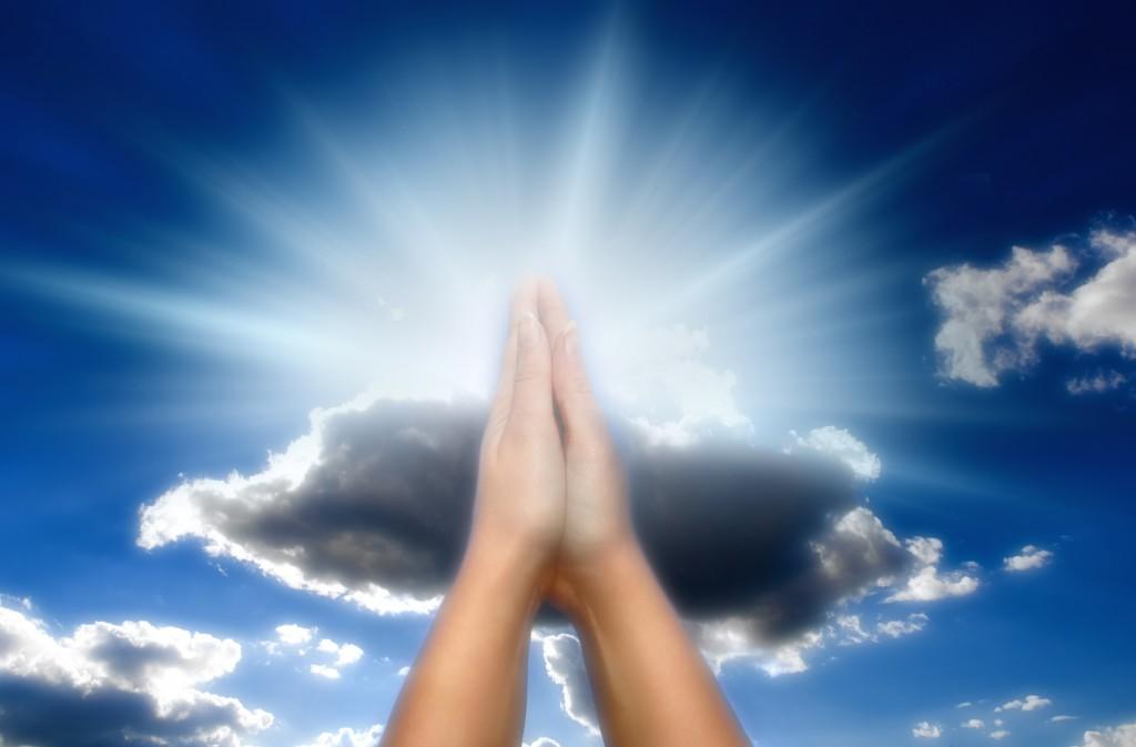 bigstock-praying-woman-over-blue-sky-wi-163792461-1024x673