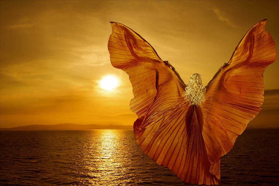 Woman with butterfly wings flying on fantasy sea sunset relaxation meditation concept
