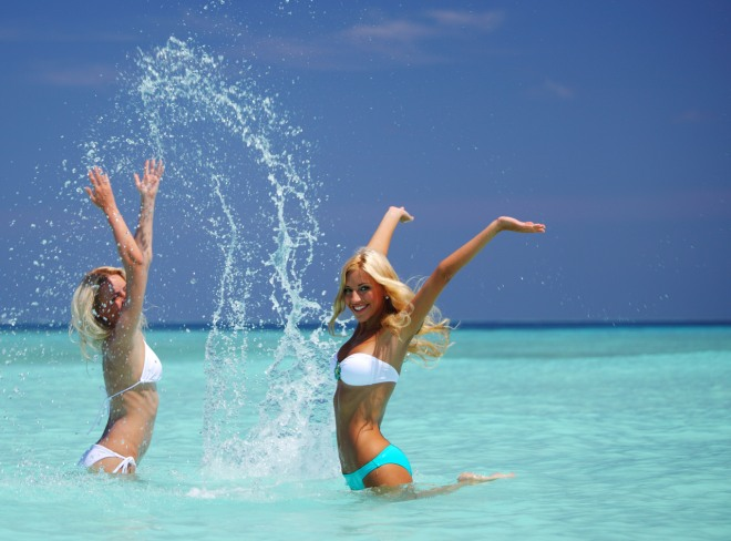 Two girls playing in ocean water